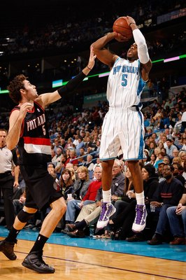 NEW ORLEANS - NOVEMBER 13:  Marcus Thornton #5 of the New Orleans Hornets shoots the ball over Rudy Fernandez #5 of the Portland Trail Blazers at the New Orleans Arena on November 13, 2009 in New Orleans, Louisiana.  NOTE TO USER: User expressly acknowled