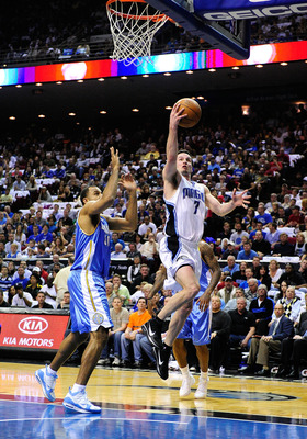 ORLANDO, FL - MARCH 28:  J.J. Redick #7 of the Orlando Magic drives against Malik Allen #30 of the Denver Nuggets during the game at Amway Arena on March 28, 2010 in Orlando, Florida.  NOTE TO USER: User expressly acknowledges and agrees that, by download