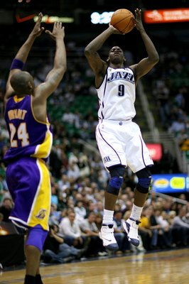 SALT LAKE CITY - APRIL 25:  Ronnie Brewer #9 of the Utah Jazz goes up for a shot over Kobe Bryant #24 of the Los Angeles Lakers in Game Four of the Western Conference Quarterfinals during the 2009 NBA Playoffs at Energy Solutions Arena on April 25, 2009 i