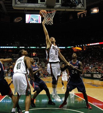 MILWAUKEE - APRIL 30: Carlos Delfino #10 of the Milwaukee Bucks puts up a shot over teammate Kurt Thomas #40 and Joe Johnson #2 and Marvin Williams #24 of the Atlanta Hawks in Game Six of the Eastern Conference Quarterfinals during the 2010 NBA Playoffs a