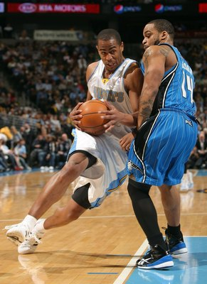 DENVER - JANUARY 13:  Arron Afflalo #6 of the Denver Nuggets drives with the ball against Jameer Nelson #14 of the Orlando Magic during NBA action at Pepsi Center on January 13, 2010 in Denver, Colorado. The Nuggets defeated the Magic 115-97. NOTE TO USER