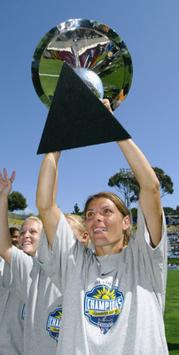 SAN DIEGO - AUGUST 24:  (FILE PHOTO)  Mia Hamm #9 of the Washington Freedom holds the Founders Cup high after their victory over the Atlanta Beat in the Founders Cup Championship Match on August 24, 2003 at Torero Stadium in San Diego, California. The WUS