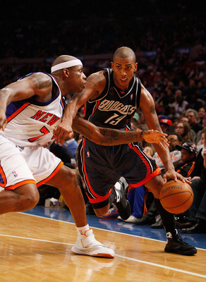 NEW YORK - MARCH 07:  Raja Bell #19 of the Charlotte Bobcats drives against Al Harrington #7 of the New York Knicks on March 7, 2009 at Madison Square Garden in New York City. NOTE TO USER: User expressly acknowledges and agrees that, by downloading and o