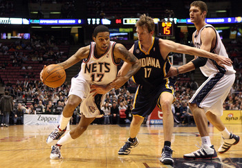 EAST RUTHERFORD, NJ - JANUARY 15:  Chris Douglas-Roberts #17 of the New Jersey Nets drives against Mike Dunleavy #17 of the Indiana Pacers at the Izod Center on January 15, 2010 in East Rutherford, New Jersey. NOTE TO USER: User expressly acknowledges and