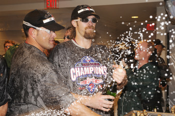 The Phillies celebrate after clinching their fourth consecutive playoff birth.
