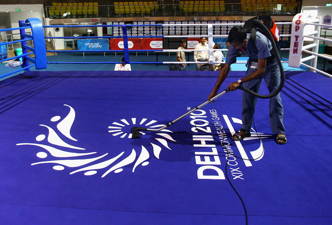 DELHI, INDIA - OCTOBER 03:  A worker clears boxing ring at Talkatora Indoor Stadium ahead of the Delhi 2010 Commonwealth Games, which open this evening, on October 3, 2010 in Delhi, India.  (Photo by Feng Li/Getty Images)
