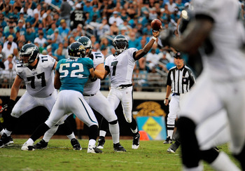 JACKSONVILLE, FL - SEPTEMBER 26:  Quarterback Michael Vick #7 of the Philadelphia Eagles throws a touchdown pass to wide receiver Jeremy Maclin #18 against the Jacksonville Jaguars at EverBank Field on September 26, 2010 in Jacksonville, Florida. The Eagl