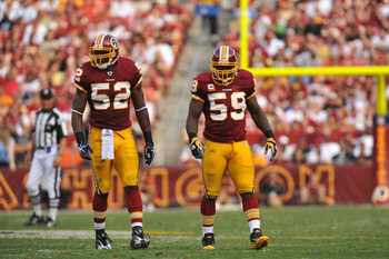 LANDOVER - SEPTEMBER 19:  Rocky McIntosh #52 and London Fletcher #59 of the Washington Redskins defend against the Houston Texans at FedExField on September 19, 2010 in Landover, Maryland. The Texans defeated the Redskins in overtime 30-27. (Photo by Larr