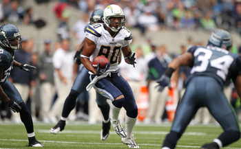 SEATTLE - SEPTEMBER 26:  Wide receiver Malcom Floyd #80 of the San Diego Chargers rushes against the Seattle Seahawks at Qwest Field on September 26, 2010 in Seattle, Washington. (Photo by Otto Greule Jr/Getty Images)
