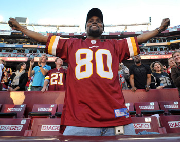 LANDOVER, MD - NOVEMBER 15:  A fan of the Washington Redskins celebrates his team's win against the Denver Broncos at FedExField on November 15, 2009 in Landover, Maryland. The Redskins defeated the Broncos 27-17. (Photo by Larry French/Getty Images)