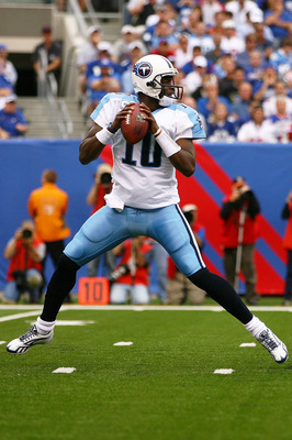 EAST RUTHERFORD, NJ - SEPTEMBER 26:  Vince Young #10 of the Tennessee Titans drops back against the New York Giants at New Meadowlands Stadium on September 26, 2010 in East Rutherford, New Jersey.  (Photo by Andrew Burton/Getty Images)