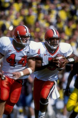 12 Sep 1998:  Quarterback Donovan McNabb #5 and fullback Rob Konrad #44 of the Syracuse Orangemen in action during a game against the Michigan Wolverines at the Michigan Stadium in Ann Arbor, Michigan. The Orangemen defeated the Wolverines 38-28. Mandator