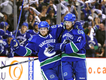 VANCOUVER, CANADA - MAY 7:  Daniel Sedin #22 and Henrik Sedin #33 of the Vancouver Canucks celebrate after Daniel Sedin scored against the Chicago Blackhawks during the first period in Game Four of the Western Conference Semifinals during the 2010 NHL Sta