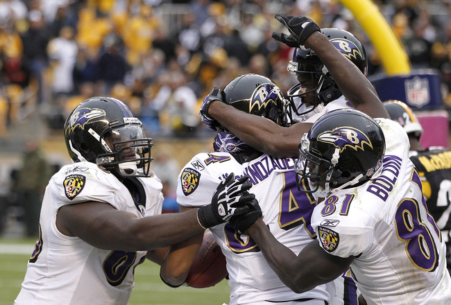 PITTSBURGH - OCTOBER 03:  T.J. Houshmandzadeh #84 of the Baltimore Ravens celebrates his game winning touchdown with teammates while playing the Pittsburgh Steelers on October 3, 2010 at Heinz Field in Pittsburgh, Pennsylvania.  (Photo by Gregory Shamus/G