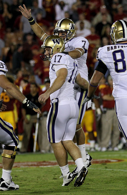 LOS ANGELES, CA - OCTOBER 02:  Kicker Erik Folk #17 and holder Cody Bruns #7 of the Washington Huskies celebrate after Folk's game winning field goal as time ran out in the game with the USC Trojans at the Los Angeles Memorial Coliseum on October 2, 2010