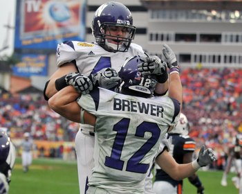 TAMPA, FL - JANUARY 1: Wide receiver Andrew Brewer #12 of the Northwestern Wildcats celebrates a touchdown pass with split back Mark Woodsum #44 against the Auburn Tigers in the Outback Bowl January 1, 2010 at Raymond James Stadium in Tampa, Florida.  (Ph