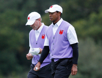 NEWPORT, WALES - OCTOBER 02:  Tiger Woods (R) and Steve Stricker of the USA walk to a green during the Fourball & Foursome Matches during the 2010 Ryder Cup at the Celtic Manor Resort on October 2, 2010 in Newport, Wales.  (Photo by Sam Greenwood/Getty Im
