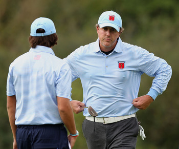 NEWPORT, WALES - OCTOBER 03:  Rickie Fowler of the USA looks on with Phil Mickelson (R) during the  Fourball & Foursome Matches during the 2010 Ryder Cup at the Celtic Manor Resort on October 3, 2010 in Newport, Wales.  (Photo by Ross Kinnaird/Getty Image