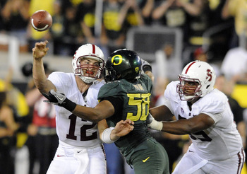 EUGENE, OR - OCTOBER 2: Quarterback Andrew Luck of the Stanford Cardinal is hit  by defensive end Kenny Rowe #58 of the Oregon Ducks in the third quarter of the game at Autzen Stadium on October 2, 2010 in Eugene, Oregon. Oregon won the game 52-31. (Photo