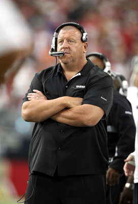 GLENDALE, AZ - SEPTEMBER 26:  Head coach Tom Cable of the Oakland Raiders stands on the sidelines during the NFL game against the Arizona Cardinals at the University of Phoenix Stadium on September 26, 2010 in Glendale, Arizona.  The Cardinals defeated th