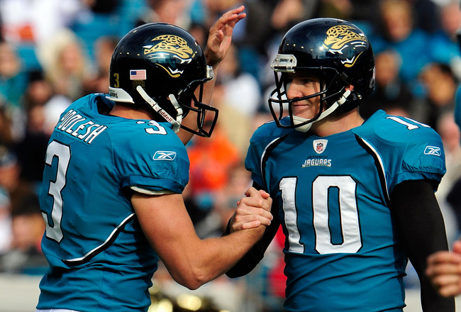 JACKSONVILLE, FL - DECEMBER 06:  Adam Podlesh #3 and Josh Scobee #10 of the Jacksonville Jaguars celebrate after a field goal during the game against the Houston Texans at Jacksonville Municipal Stadium on December 6, 2009 in Jacksonville, Florida.  (Phot