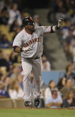 LOS ANGELES, CA - SEPTEMBER 04:  Juan Uribe #5 of the San Francisco Giants begins to run to first base after hitting a two-run home run against the Los Angeles Dodgers in the ninth inning at Dodger Stadium on September 4, 2010 in Los Angeles, California.