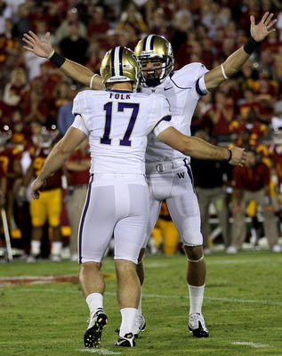 LOS ANGELES - OCTOBER 2:  Kicker Erik Folk #17 and holder Cody Bruns #7 of the Washington Huskies celebrate after Folk's game winning field goal as time ran out in the game with the USC Trojans at the Los Angeles Memorial Coliseum on October 2, 2010 in Lo