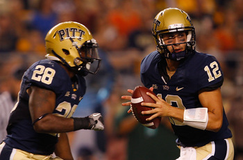 PITTSBURGH - SEPTEMBER 23:  Tino Sunseri #12 of the Pittsburgh Panthers drops back to pass in front of teammate Dion Lewis #28 during the game against the Miami Hurricanes on September 23, 2010 at Heinz Field in Pittsburgh, Pennsylvania.  (Photo by Jared