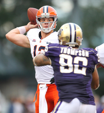 SEATTLE - SEPTEMBER 11:  Quarterback Ryan Nassib #12 of the Syracuse Orange passes against Everrette Thompson #92 of the Washington Huskies on September 11, 2010 at Husky Stadium in Seattle, Washington. The Huskies defeated the Orange 41-20. (Photo by Ott