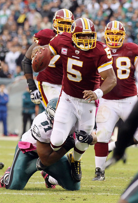 PHILADELPHIA - OCTOBER 03:  Donovan McNabb #5 of the Washington Redskins runs the ball against Darryl Tapp #91 of the Philadelphia Eagles  on October 3, 2010 at Lincoln Financial Field in Philadelphia, Pennsylvania.  (Photo by Jim McIsaac/Getty Images)