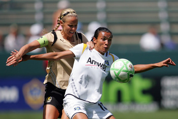 CARSON, CA - APRIL 19:  Marta Vieira da Sliva #10 of the Los Angeles Sol holds off a challenge by Leslie Osborne #10 of FC Gold Pride in the second half during the WPS match at The Home Depot Center on April 19, 2009 in Carson, California.  The Sol defeat