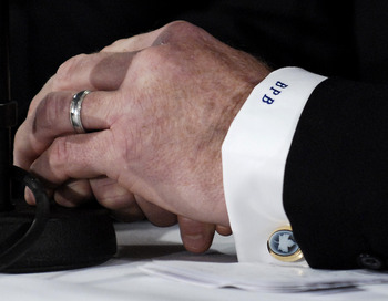 TORONTO - NOVEMBER 29:   Brian Burke wears Toronto Maple Leafs cuff links during a press conference after being named the teams President and General Manager November 29, 2008 at the Air Canada Centre in Toronto, Ontario, Canada. (Photo by Brad White/Gett