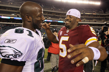 PHILADELPHIA - OCTOBER 03:  Donovan McNabb #5 of the Washington Redskins meets with Jason Avant #81 of the Philadelphia Eagles after their game on October 3, 2010 at Lincoln Financial Field in Philadelphia, Pennsylvania. The Redskins defeated the Eagles 1