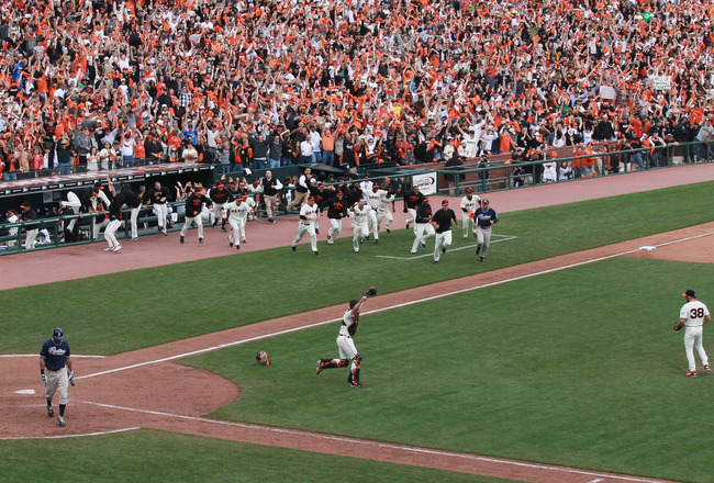 SAN FRANCISCO - OCTOBER 03:  San Francisco Giants players rush the field after clinching the National League West divsion against the San Diego Padres at AT&T Park on October 3, 2010 in San Francisco, California.  The Giants beat the Padres 3-0.  (Photo b