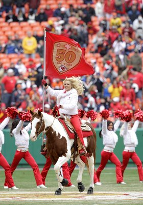 KANSAS CITY, MO - DECEMBER 6:  A cheerleader of the Kansas City Chiefs rides a horse onto the field carrying a Kansas City Cheifs flag prior to the NFL game against the Denver Broncos on December 6, 2009 at Arrowhead Stadium in Kansas City, Missouri. The