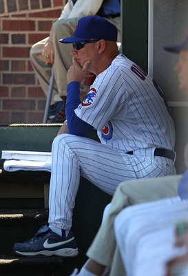 CHICAGO - SEPTEMBER 24: Interim manager Mike Quade #8 of the Chicago Cubs watches as his team takes on the St. Louis Cardinals at Wrigley Field on September 24, 2010 in Chicago, Illinois. The CArdinals defeated the Cubs 7-1. (Photo by Jonathan Daniel/Gett