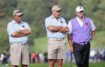 NEWPORT, WALES - OCTOBER 02:  USA Team caddies Jimmy Johnson (L) and Steve Williams (C) wait alongside Steve Stricker during the rescheduled Afternoon Foursome Matches during the 2010 Ryder Cup at the Celtic Manor Resort on October 2, 2010 in Newport, Wal