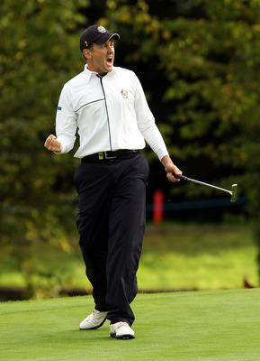 NEWPORT, WALES - OCTOBER 03:  Ian Poulter of Europe celebrates holing a putt on the 15th green  during the  Fourball &amp; Foursome Matches during the 2010 Ryder Cup at the Celtic Manor Resort on October 3, 2010 in Newport, Wales.  (Photo by Ross Kinnaird/Get