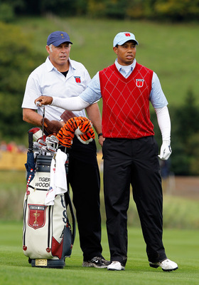NEWPORT, WALES - OCTOBER 03:  Tiger Woods of the USA lines up a shot with caddie Steve Williams during the  Fourball &amp; Foursome Matches during the 2010 Ryder Cup at the Celtic Manor Resort on October 3, 2010 in Newport, Wales.  (Photo by Sam Greenwood/Get