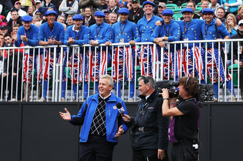 NEWPORT, WALES - OCTOBER 02:  Europe Team Captain Colin Montgomerie is interviewed by Tim Barter of Sky TV in front of a group of Ryder Cup fans on the first tee during the  Fourball & Foursome Matches during the 2010 Ryder Cup at the Celtic Manor Resort