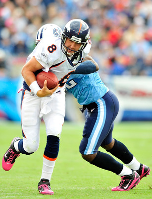 NASHVILLE, TN - OCTOBER 03:  Vincent Fuller #22 of the Tennessee Titans tackles quarterback Kyle Orton #8 of the Denver Broncos during the first half at LP Field on October 3, 2010 in Nashville, Tennessee.  (Photo by Grant Halverson/Getty Images)