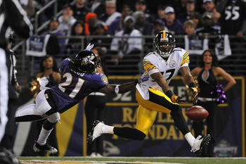BALTIMORE - NOVEMBER 29:  Mike Wallace #17 of the Pittsburgh Steelers can't hold onto a pass in the endzone while Lardarius Webb #21 defends during the game against the  Baltimore Ravens at M&T Bank Stadium on November 29, 2009 in Baltimore, Maryland. The