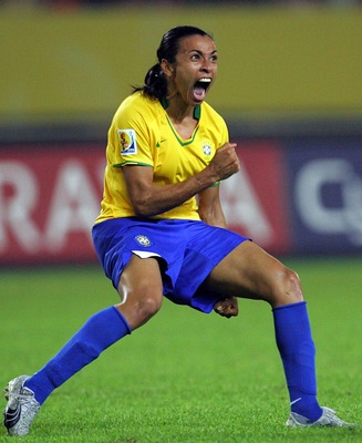 HANGZHOU, CHINA - SEPTEMBER 27: Marta Vieira Da Silva #10 of Brazil reacts after scoring a goal against USA during the semifinal of the Women's World Cup 2007 at Hangzhou Dragon Stadium on September 27, 2007 in Hangzhou, China.  (Photo by Ronald Martinez/