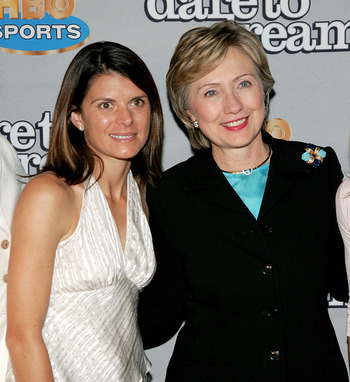 NEW YORK - NOVEMBER 29:  Member of the gold medal winning U.S. Women's National Team at the 1996 Olympic Games, Mia Hamm (L), poses for a photo with Senator Hillary Rodham Clinton as they attend the HBO Sports Premiere of 'Dare to Dream' at Loews Cineplex