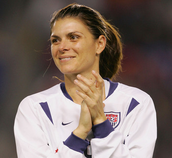 CARSON, CA - DECEMBER 8:  Mia Hamm #9 of USA gestures as she is honored during a pregame ceremony before taking on Mexico during the 'Fan Celebration Tour' finale on December 8, 2004 at The Home Depot Center in Carson, California.  (Photo by Lisa Blumenfe
