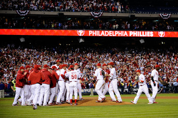 PHILADELPHIA - OCTOBER 21:  The Philadelphia Phillies celebrate defeating the Los Angeles Dodgers 10-4 to advance to the World Series in Game Five of the NLCS during the 2009 MLB Playoffs at Citizens Bank Park on October 21, 2009 in Philadelphia, Pennsylv