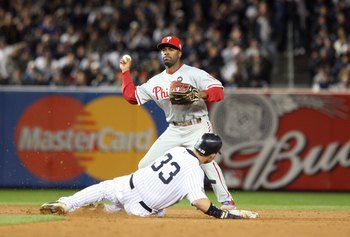 NEW YORK - NOVEMBER 04:  Jimmy Rollins #11 of the Philadelphia Phillies forces out Nick Swisher #33 of the New York Yankees on a fielder's choice in the bottom of the sixth inning of Game Six of the 2009 MLB World Series at Yankee Stadium on November 4, 2