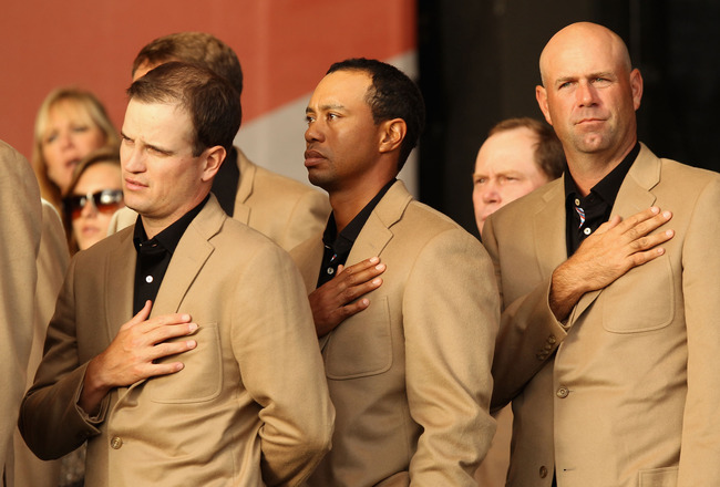 NEWPORT, WALES - OCTOBER 04:  USA Team members (L-R) Zach Johnson, Tiger Woods and Stewart Cink at the closing cermonies following Europe's 14.5 to 13.5 victory over the USA at the 2010 Ryder Cup at the Celtic Manor Resort on October 4, 2010 in Newport, W