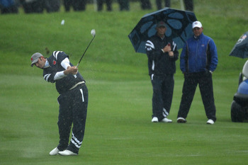 NEWPORT, WALES - OCTOBER 01:  Dustin Johnson of the USA hits a shot on the second hole as the rain falls during the Morning Fourball Matches during the 2010 Ryder Cup at the Celtic Manor Resort on October 1, 2010 in Newport, Wales.  (Photo by Ross Kinnair