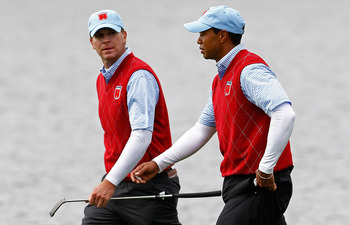 NEWPORT, WALES - OCTOBER 03:  Tiger Woods of the USA chats with team mate Steve Stricker (L) on the 13th hole during the Fourball & Foursome Matches during the 2010 Ryder Cup at the Celtic Manor Resort on October 3, 2010 in Newport, Wales.  (Photo by Sam